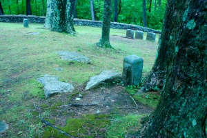 Sacrificial Stones in the center of the cemetery surrounded by trees or rocky New England terrain... ;-)